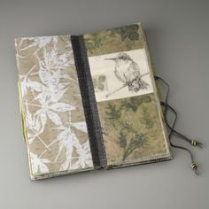 handmade book by Sharon McCartney - Mixed Media Coptic Bound Book with printed and embroidered organdy pages