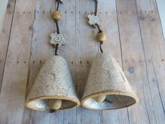 One Ceramic Bell is $15.00 I have handmade these bells out of speckled clay. Glazed with pure white glaze. I have attached a leather cord with