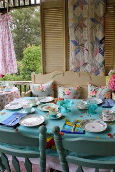 Aiken House & Gardens ~~~ I really kind of like the mish-mosh of plates, napkins & teacups....