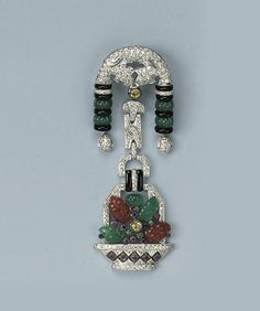 A GEM-SET AND DIAMOND BROOCH   Designed as a diamond set basket with carved chalcedony flowers suspended from diamond set links to the arched surmount with carved chalcedony and onyx beads. Art Deco or Art Deco style