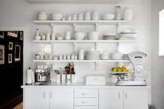 white kitchen sideboard + shelves , white hardware on white cabinetry