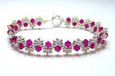 Ruby and silver crystal swarovski bracelet ruby by BuzzybeeBeading