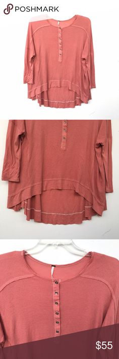 Free People Pink Benedict Henley Never worn Free People Benedict Henley in a pink-orange color. High low, and buttons down a few inches. Free People Tops Tees - Long Sleeve