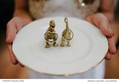 Gold dinosaur wedding ring holders | Photo by Casey Pratt