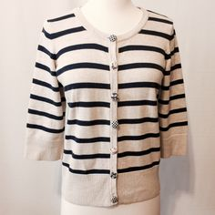 """Just In Cute Preppy Khaki & Navy Cardigan Great updated classic to add to your wardrobe.  Scooped neckline, three quarter sleeves, 3"""" ribbed trim on hem and sleeves. Contrasting silk buttons closure. 100% cotton Machine washable 36"""" bust 21"""" overall length Christopher & Banks Sweaters Cardigans"""