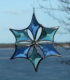 3D Blue and Green Stained Glass Flower Snowflake Suncatcher. $50.00, via Etsy.