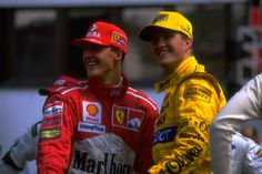 image: Michael Schumacher of Germany (left) shares a joke with his brother, Ralf, before the Hungarian Grand Prix at Hungaroring in Hungary, on Aug. 10 1997.