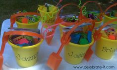 Sand pail party favors for beach themed party