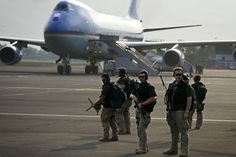 Security personnel stand guard as George W. Bush transfers from Air Force One to Marine One in Jakarta, Indonesia, November, Photograph by Brooks Kraft. Special Ops, Special Forces, Ghost Recon 2, United States Secret Service, Executive Protection, Trump Is My President, Air Force Ones, Police