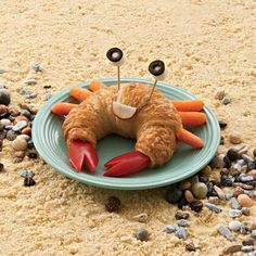 Fun, healthy snack - a crab croissant with carrot legs. I would prob use cheerios for the claws - would go nicely