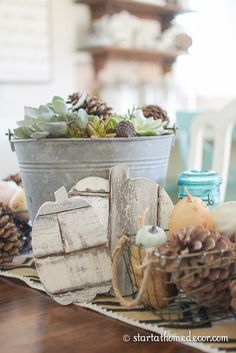 Fall centerpiece with shiplap pumpkins, pinecones, gords, succulents and burlap!