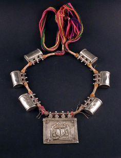 This is an amazing Rajasthan silver tribal necklace, in its original string and composition. The central rectangular amulet pendant was