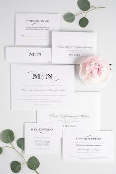 Ornate, vintage, and elegant monogram wedding invitations in black and white with bold engraver's typography