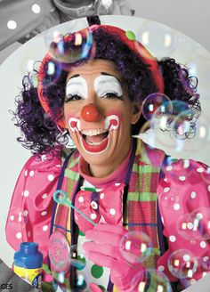 Another image of Lovely Buttons the Clown. (Don't know where I found this one either.) Again, her makeup looks so simple and easy.