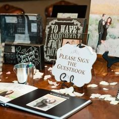 Guest sign in table with guest book and numerous pictures of the bride and groom | Leslie Ann Photography | villasiena.cc