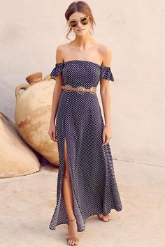 The Dream Love Navy Blue Polka Dot Off-the-Shoulder Maxi Dress has captured our hearts! Woven cream and navy blue polka dot fabric is formed to a darling, off-the-shoulder neckline with short sleeves.