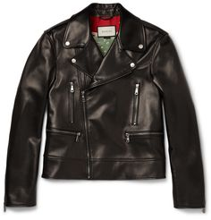 Gucci - Leather Biker Jacket 3980 EUR / $5380. Gucci's pleasingly substantial leather biker jacket is every inch a luxury investment. Its boxy shape and silver hardware nod to the design's rock 'n' roll roots, but the printed silk lining gives it a new level of sophistication. The ornate pattern depicts swooping eagles and blooming botanicals for an artisanal feel.