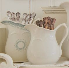 Silver stored in pretty pitchers.