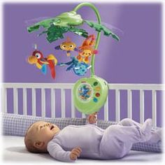 BABYTOYS - RAINFOREST   Ages  birth and up  This musical mobile's leaves gently open and close as rainforest friends dance and spin for baby.