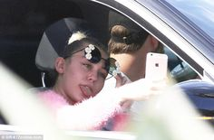 Tired of it already? It appears Liam Hemsworth is no longer enamored with Miley Cyrus' tongue-out selfies as he ignored her mini photo shoot during a drive on Thursday in LA