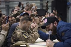 https://flic.kr/p/PVLmW3 | 161207-D-PB383-095 | Scarlett Johansson and Chris Evans perform for service members during the USO Holiday Tour at Bagram Air Base, Afghanistan, Dec. 7, 2016. Marine Gen. Joseph F. Dunford, Jr., chairman of the Joint Chiefs of Staff, along with USO entertainers, visited service members who are deployed from home during the holidays at various locations across the globe. This year's entertainers included actors Chris Evans, actress Scarlett Johansson, NBA Legend…