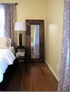 $35 DIY floor mirror: Walmart door mirror, wood, stain, mirror clips, gorilla glue, staple gun (brackets?)