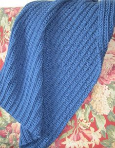 Free Knitting Pattern for Easy One Row Repeat Blanket - Easy afghan with a one row repeat stitch pattern designed by skullsnbats. Pictured project by andymeg.