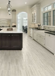 Modern Kitchen Design Kitchen Flooring Ideas Vinyl - However, you often forget to pick kitchen floor ideas that can add a nuance to your kitchen and upgrade its look. So, check out these 14 alluring kitchen floor ideas that will make your day. Best Flooring For Kitchen, Vinyl Flooring Kitchen, Kitchen Vinyl, Kitchen Tiles, New Kitchen, Kitchen Decor, Concrete Kitchen, Kitchen Cabinets, Stylish Kitchen
