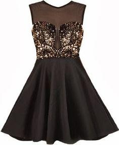 Para festas de 15 anos, esse vestido arrasa com a parte de cima trabalhada no bordado e tule, e parte de baixo um preto cintilante