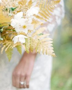 Golden hued ferns, perfectly picking up on the cheery tones at the center of this Japanese anemone. Florals: @sagefloral | Photo: @_jacquelyn_hayward | Gown: @shopgossamer  #weddingflowers #bridalbouquet #weddingbouquet #fallwedding
