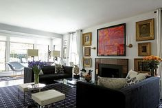 In the living room, Empire sconces, a bronze Grand Tour sculpture and 18th-century oil paintings ranging from portraiture to Orientalist paintings and interiorscapes. Painting above the fi replace by artist Michael Tracy. Mitchell Gold + Bob Williams black Ultraseude sofas. Vintage Le Corbusier cowhide chairs and coffee table. Rug from Creative Flooring Resources.