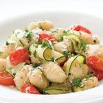 Artichoke hearts, olives and a splash of red-wine vinegar give this ultra-quick, healthy vegetarian gnocchi recipe pizzazz. For an additional hit of Mediterranean flavor, try topping with feta cheese.