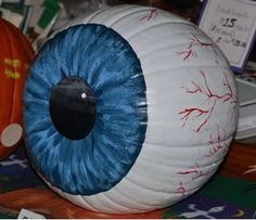 """Freaky eyeball pumpkin requires no carving."" ~Except i'm still going to carve a center out"