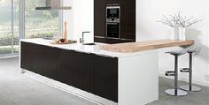 Keukenrenovatie? Combineer eens moderne elementen met hout!