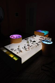 Love the multi layers of light in this particular set up- adds complexity and interest This is a beautiful light table