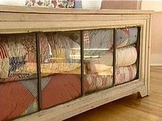 Construct a coffee table using a leaded glass window for a hinged top. Antique quilts are stored inside. I need someone to make me one of these!