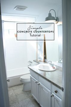 Cover your ugly laminate counters with concrete using this Simple Concrete Countertops Tutorial! Also, I love the barn light inside!