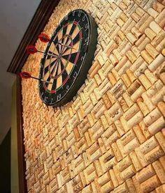 Wine cork wall behind the dart board. Cool idea for a bar/gameroom.
