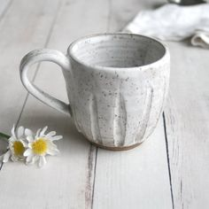 This rustic mug was hand thrown and trimmed on my pottery wheel using a brown speckled stoneware clay. It hand carved and then bisque fired, glazed with a matte white glaze that allows the natural . Stoneware Mugs, Ceramic Mugs, Ceramic Bowls, Pottery Mugs, Ceramic Pottery, Clay Projects, Clay Crafts, Rustic Mugs, Pretty Mugs