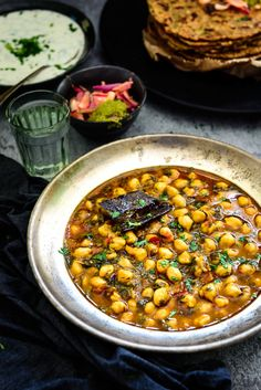 Methi Chole or spicy fenugreek and chickpea curry is a delicious gravy dishes prepared all over India in a variety of ways. It is a healthy way to include greens and protein in your diet. It is also a great way to get your kids to eat them.