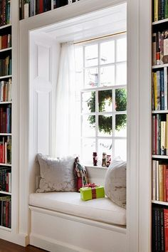 Wall of bookcases with window seat... Love this!!! I would want to make the seat a bench so you could store some blankets in there. :)