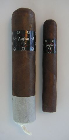 Large Asylum 13 Eighty cigar with 80 ring gauge next to Robusto with 50 ring for comparison. For more, please visit:   http://cigarczars.com/largest-cigars.htm