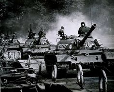 Column of polish T-55 tanks crossing a river.