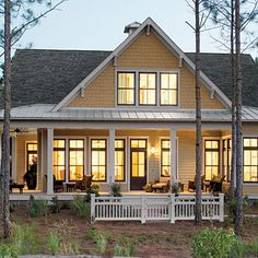 17 pretty house plans with porches Tucker Bayou - Plan No. 1408 Inspired by historic seaside architecture, this design combines the comfort . The Plan, How To Plan, Style At Home, Bungalows, Plan Chalet, Porch House Plans, Lake House Plans, Southern Living House Plans, Southern Homes