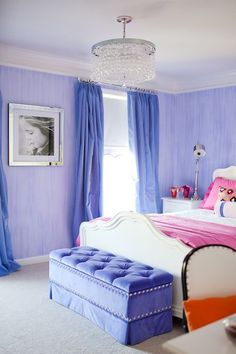 Periwinkle walls and curtains. White bed. Pink and white bedding.