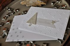 hand crafted Christmas card from Stembelsche ... white with a touch of gold ... clean and simple ... elegant look .... small stars embossing folder ... die cut triangle tree and star from gold glitter paper ... Stampin' Up!