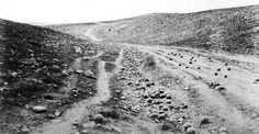 In the Valley of the Shadow of Death.  A photograph taken during the Crimean war (one of the first wars, along with the American civil war to be photographed).  It shows a road in the Ukraine filled with cannon balls from a recent battle.  As it turns out, the cannon balls were placed there by the photographer.
