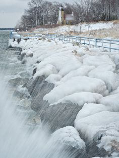 Waves crash against the icy breakwater in the channel guarded by the White River Light Station, Michigan Lake Michigan, Michigan Usa, Grands Lacs, Frozen, White Lake, Great Lakes, Winter Scenes, Travel Usa, Winter Wonderland