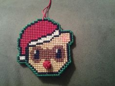 This is my ferret christmas ornament I made its cross stitch not perler like some other person who pinned it on here, I sell them on etsy