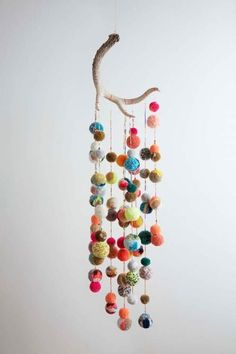 Deer Antler Pom Pom Mobile | This is great, but I think if the antler was a little bigger and less pom poms (or at least more spread out) it would look better. Would also make a cool art piece too.
